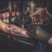 professional-tattoo-artist-makes-a-tattoo-on-a-P4GQEU6
